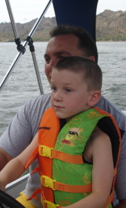 Rod teaching Jakob to drive the boat